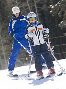 Adaptive skier with child
