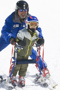 Adaptive skier with young child